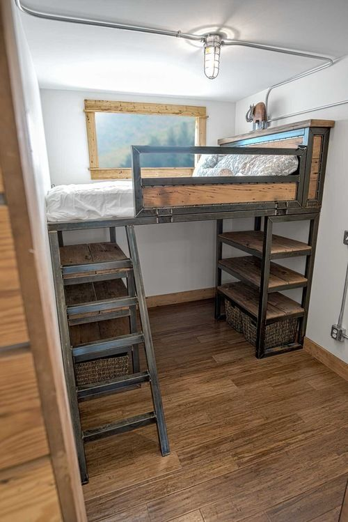 bedroom interior with full size loft bed with storage underneath for Freedom shipping container home - $80,000 installed
