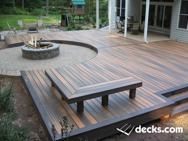 Low profile composite deck surrounding a circular paver fire pit. Deck benches.