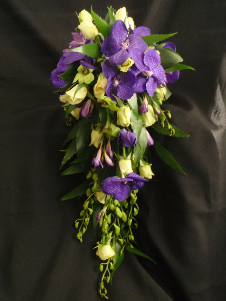 Open Trail wedding bouquet with Roses, Vanda Orchid and Singapore Orchid. Created by Poppies and Peas Floral Design.