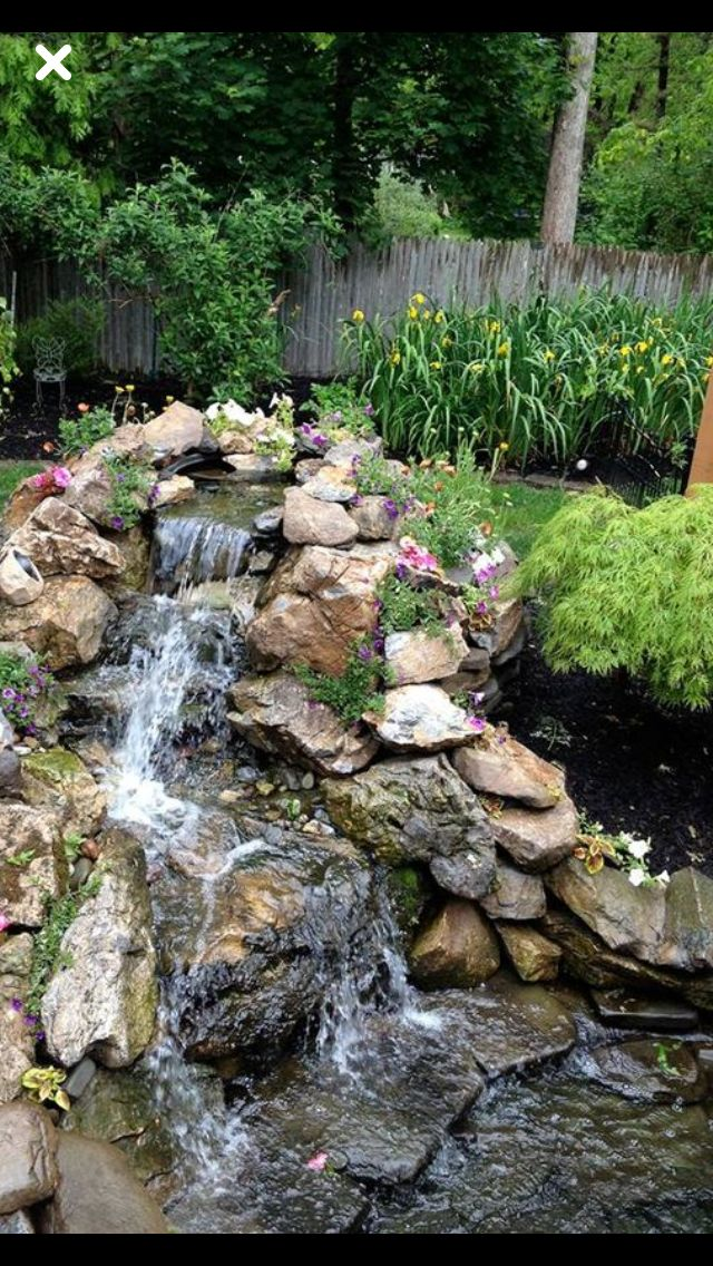 Backyard Waterfalls Ideas this pond with a stone waterfall is slightly off the beaten path of the yard Backyard Waterfalls