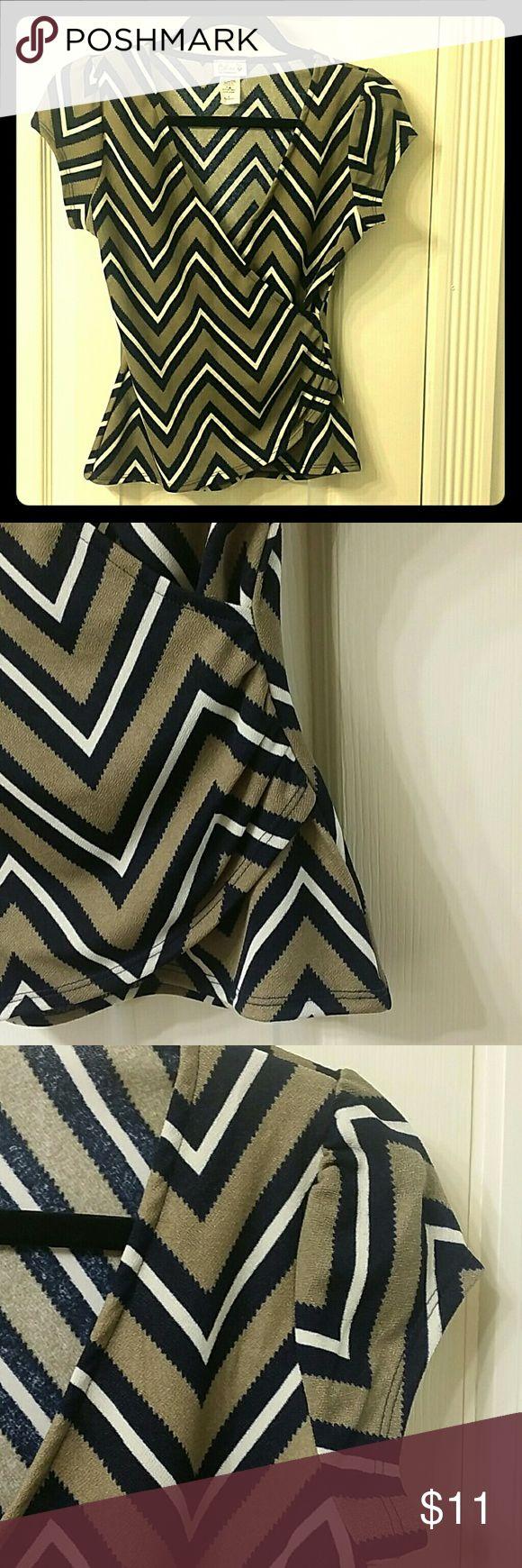 Chevron blouse wrap front. V neck. Some spandex. Chevron blouse wrap front. Some spandex. Gathered at side. Figure flattering. Celine Tops Blouses