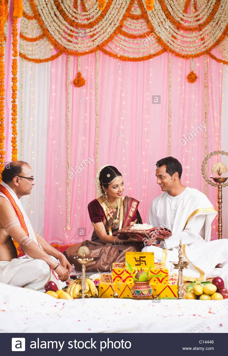 jain wedding invitation wording in hindu%0A Bridegroom giving a sari to the bride at the South Indian wedding ceremony  Stock Photo