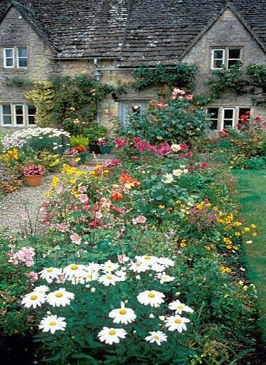 Flower and veggie garden with a cottage....English countryside