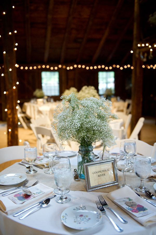 Elegant Vintage Themed Wedding table decor.  Arrangement of solid babies breath.  Elegant!