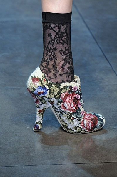 3a. These tapestry shoes create a striking contrast with black lace pop socks. Both lace and tapestry are common elements in the baroque fashion revival and look great together. Also this style is similar to ones made popular by Louis XIV