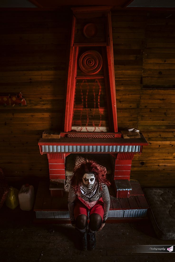 #fireplace #freaky #stripes #red #clown_makeup #halloween #smile #mattress #circles #wood