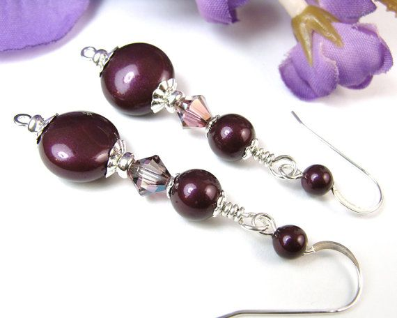 Blackberry pearl and lilac shadow crystals combine beautifully with sterling silver in these elegant handmade dangle earrings. The pearls and crystals are from Swarovski (made in Austria), with richly deep berry-hued coin beads and rounds accented by sparkly bicones. The pearls are very shiny and reflective, making them difficult to photograph, but this gives them a light-catching quality that will make them more noticable when worn. The sterling silver bead caps add to the shine, with…