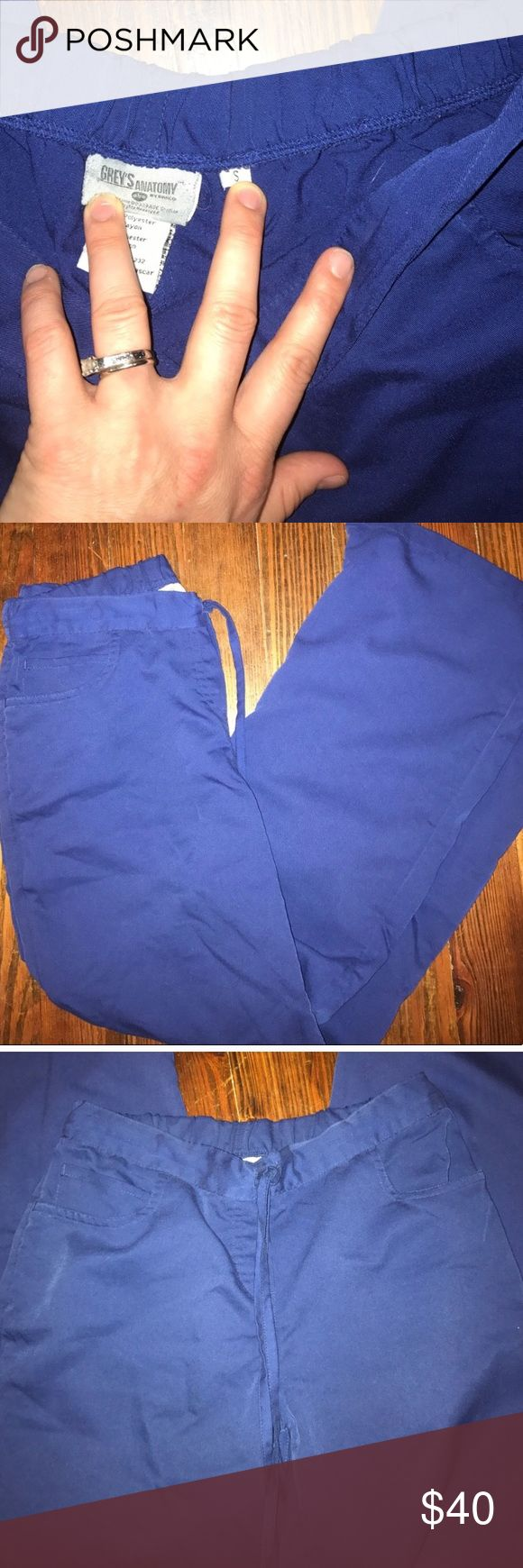 """Greys anatomy scrub set This color I believe is Heather. This color is between a royal blue and navy blue. If you compared them to both royal blue and navy blue you can definitely tell there is a color difference! These would be great for those who don't have color assigned colors. These are in excellent condition! Both size small. Inseam 30"""" for pants. Have only been worn a few times. greys anatomy Other"""