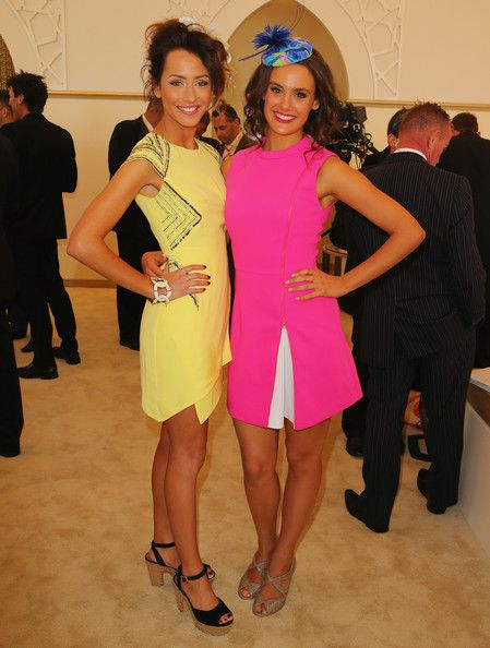 Isabella Giovinazzo and Cassie Howarth attend the Emirates marquee during Stakes Day at Flemington Racecourse on November 9, 2013 in Melbourne, Australia.