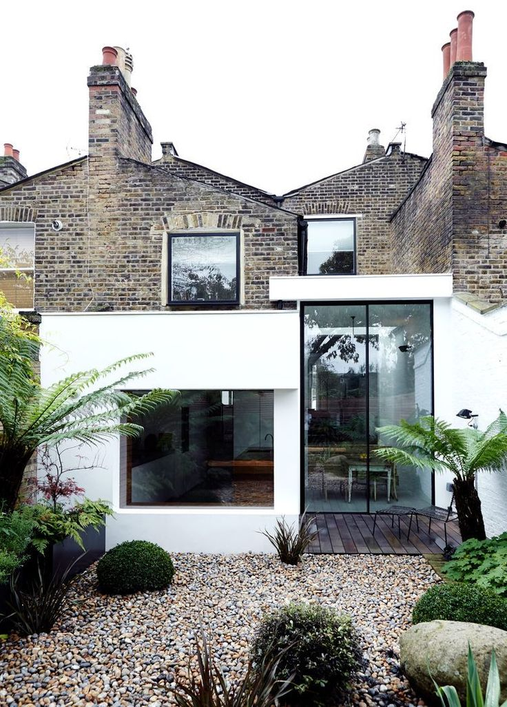 A London house with Victorian brick, a modern extension, and Velfac windows.