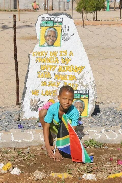A child from Viljoensdraai in Onseepkans plants the SA flag in honour of #MandelaDay. Picture: @wallycloete