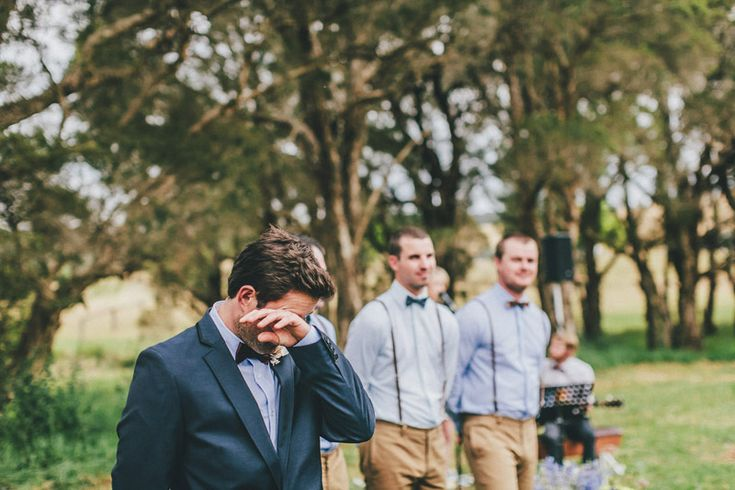 Groom's reaction <3 THIS IS A MUST for our photos. Im sure I wouldn't get this reaction but capturing whatever reaction it is would be cute.