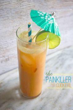 The Painkiller - 2 oz. dark rum, 4 oz. pineapple juice, 1 oz. orange juice, 1 oz. sweetened coconut cream, 5 ice cubes, slice of lime, for garnish