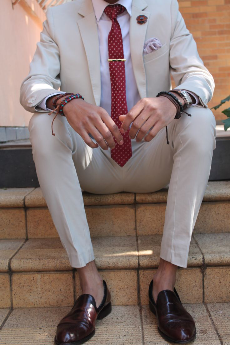 Suit and tie things....wrist watch, bracelets and brown loafers. STEEZ