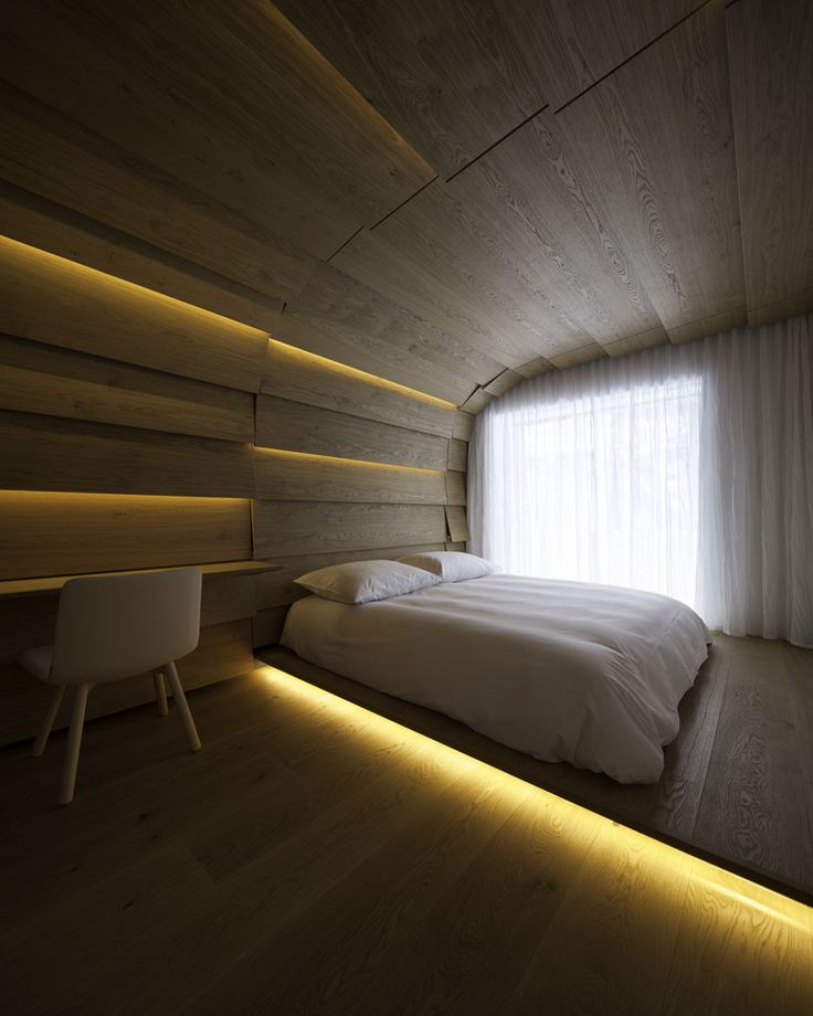 Therme Vals Vals, Switzerland 2014.08 Hotel-Guestrooms Renovation 700 m2 The project was to renovate an apartment for the hotel staff to guest rooms. We aimed for rooms like caves filled with warmth and intimacy. The basic unit is an oak panel of 40cm width. The room is covered by the units that extend to the whole space, with one side of the panel overlapping the side of the next one. Lights are set between the panels, which is an attempt to integrate the interior and the lighting. The bed…