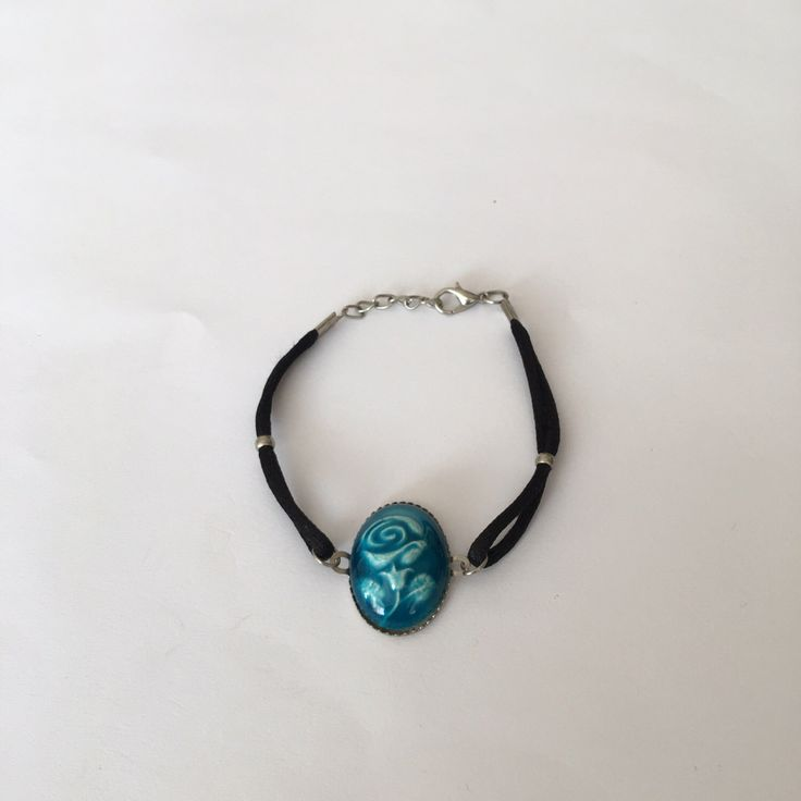 A personal favourite from my Etsy shop https://www.etsy.com/listing/267498283/blue-rose-designed-ceramic-bracelet