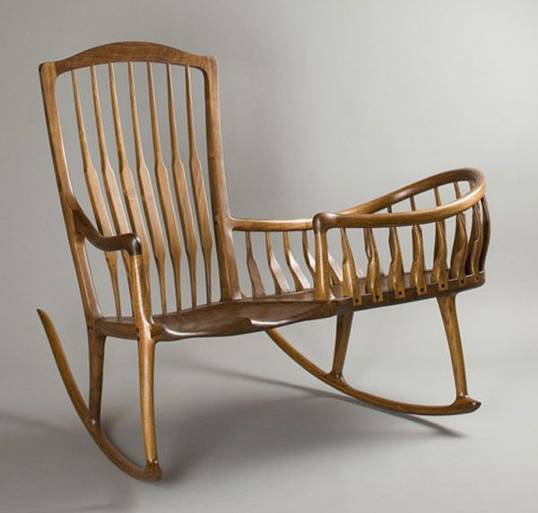 Scott Morrison's Rocker Cradle is exactly what it sounds like: a rocking chair and cradle in one. According to Scott, his design is a reinterpretation of a 1700's Windsor Nanny Rocker. Crafted of English Walnut, the piece is not only functional, it's also a work of art.