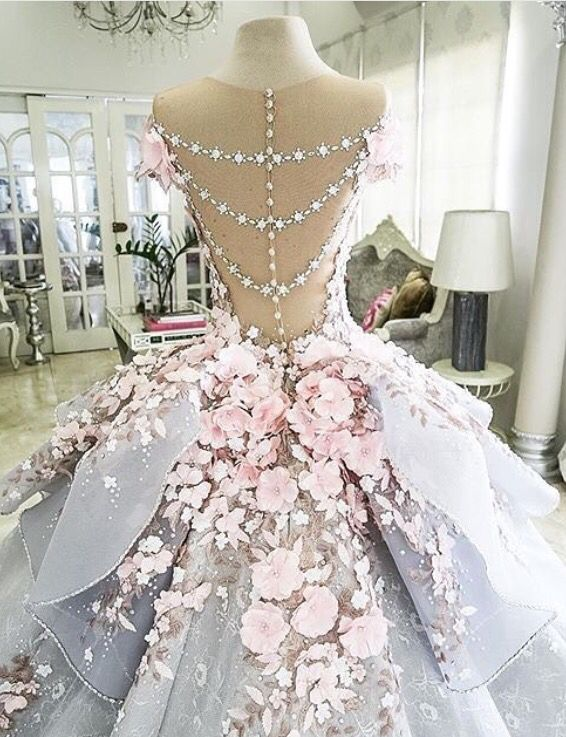 I see this as an outdoor spring wedding. Delicate colors with an open back. I little poofy for my taste but you never know until it's on.