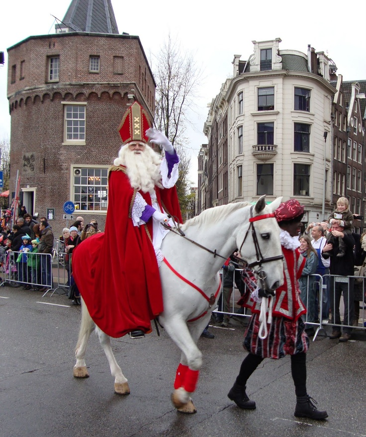 December 5th Christmas Tradition in Amsterdam, SinterKlaas and Swartz Piet arrive from Spanje