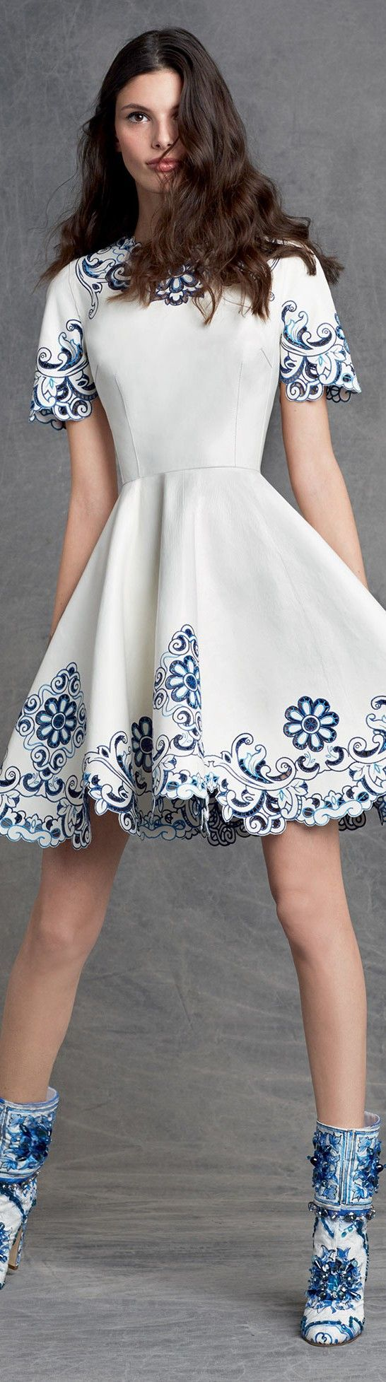 Dolce & Gabbana skater dress with detailed hems and matching boots.: