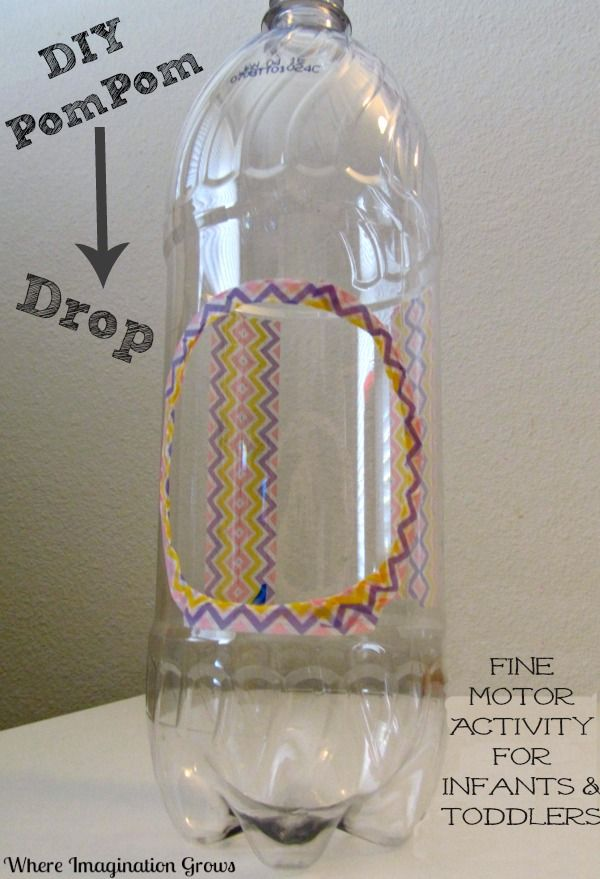 Pompom drop fine motor activity for infants & toddlers using a recycled bottle.