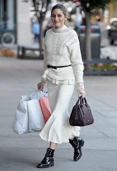 Olivia Palermo wearing oversized cream sweater, midi skirt and boots layering look | ASOS Fashion & Beauty Feed