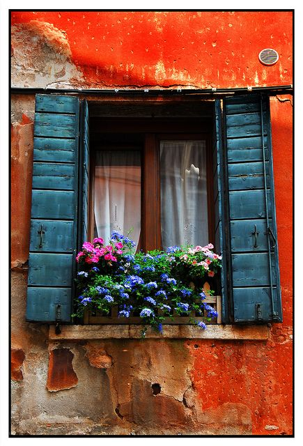 Red wall, blue shutters
