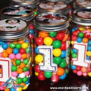 Like this idea! Just going to change it up a little to my own style. (Mason jars filled with candy & candle of age with picture on top!)