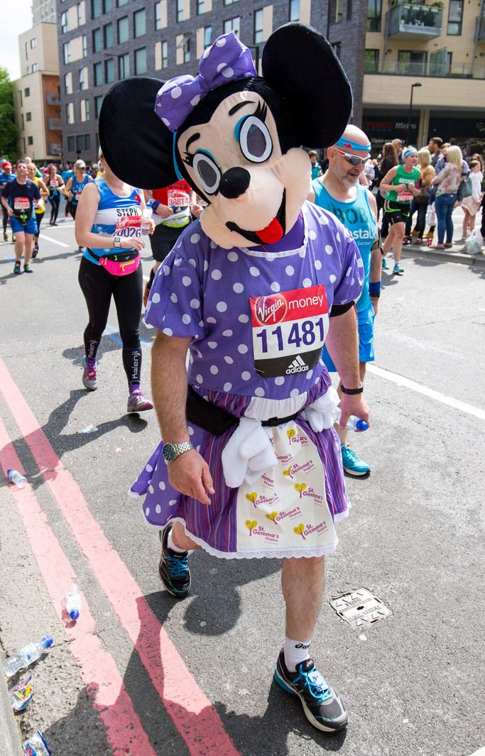 Minnie Mouse costumes like this one aren't hard to find in Times Square or on Hollywood Boulevard, but what's different here is that she's wearing Asics and has hair on her arms. Asics camel london marathon 2017