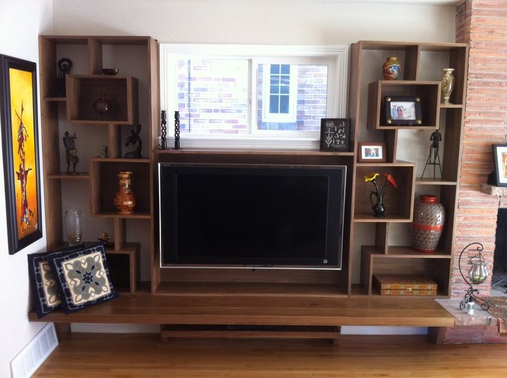 Mid-Century Modern built-in entertainment center and seating area in solid Walnut.
