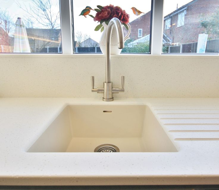 Corian sink with Mistral work top has a seamless finish. Designed, Supplied and Installed by KITCHENCRAFT Essex. www.kitchen-craft.net