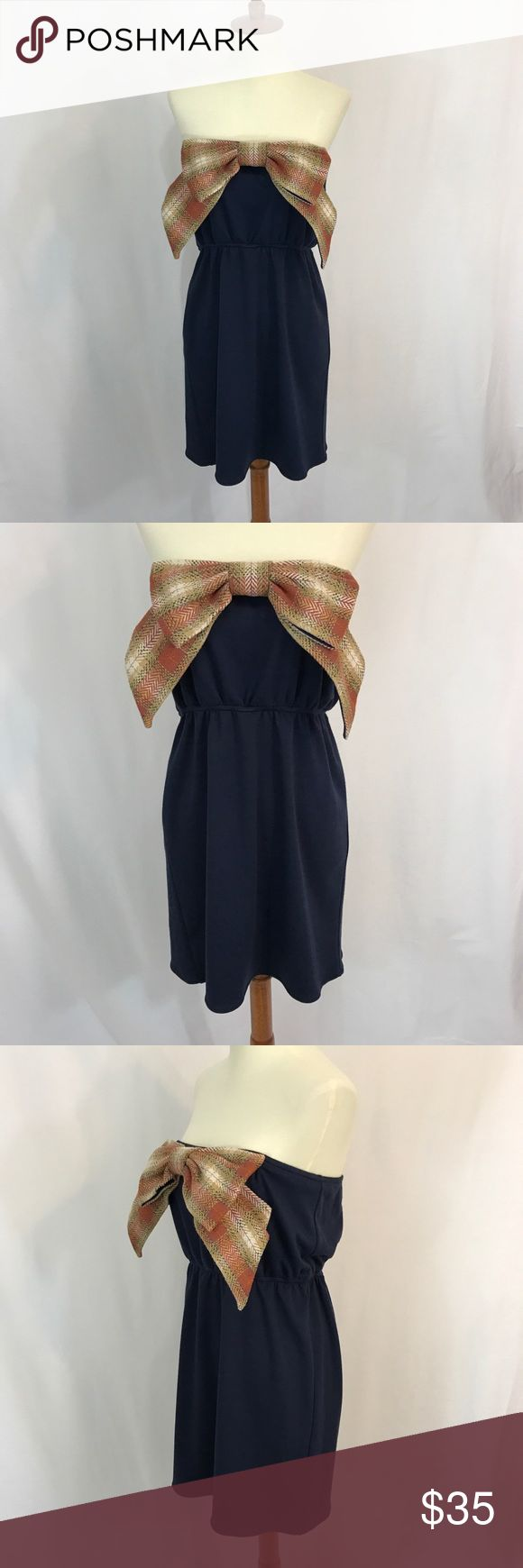 Judith March bow strapless dress Super cute! Bow design on front blouson style waist. Excellent condition! Judith March Dresses Strapless