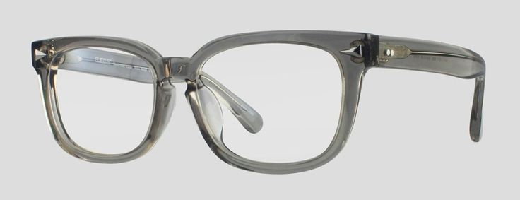 Utrecht by Reor.  Transparent Gray acetate Wayfarer style frame. Larger lenses, but made to fit a narrower face.  $31.90 (incl. single-vision prescription lenses and all lens coatings!).  F10.635UGY  Available in 3 colors.