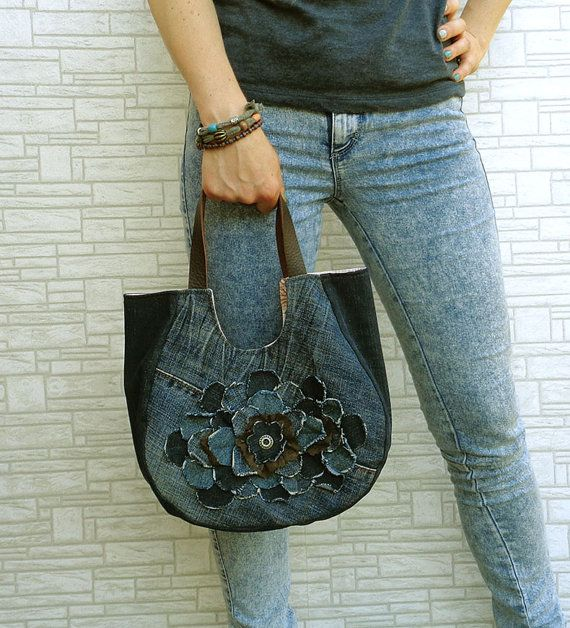 Handmade denim slouchy tote bag. Rock, Gypsy, Boho, Street style, Urban fashion.  Raw edges flower with some brown lace and leather handles.  Made of recycled denim. I do my bit to save the Planet :) Always prewashed and surely no marks and spots.  Cotton lining. Magnet closure. Zipped pocket inside.  The bag is small to medium size. Fatty shape. To wear in hand or on elbow.  Width at top - 12. Height - 10. Depth at bottom - 5. Handle is short. Drop in the middle - 8. To wear in hand or on…