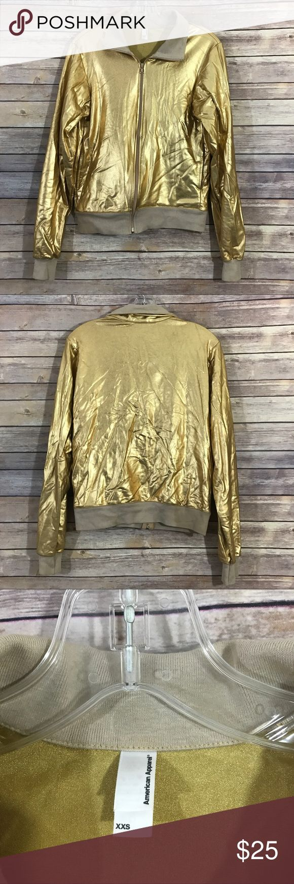 """American apparel gold lame zip up jacket XXS, 416 This American Apparel gold lame jacket is everything! It is so fun and has a standard zip up but no hood. It is in good preowned condition with no known flaws and light overall wear. This jacket is a size XXS measuring 16"""" flat across the bust and is 23"""" long. American Apparel Jackets & Coats"""
