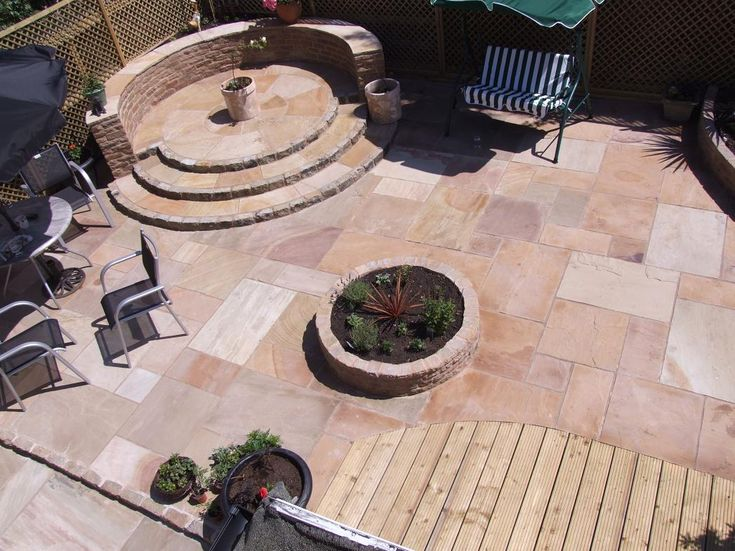 A large Natural Stone Paving garden makeover including a raised circle patio feature and a raised circle flower bed. A low maintenance garden #LandscapingLiverpool  http://www.abellandscapes.co.uk/paving-liverpool