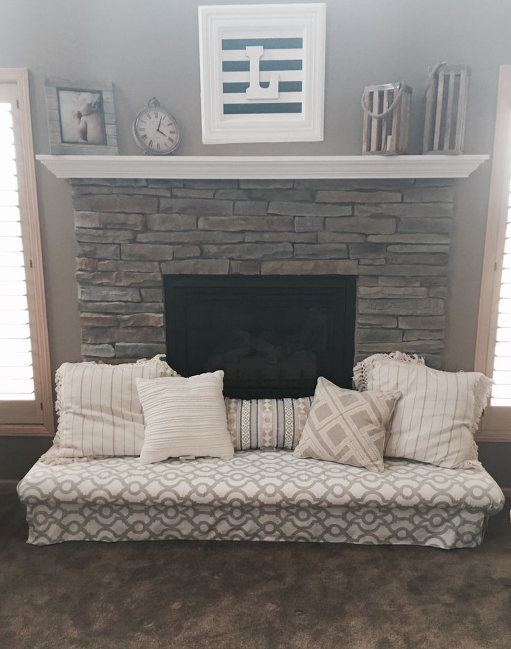 Baby-proof the fireplace hearth with a padded bench!