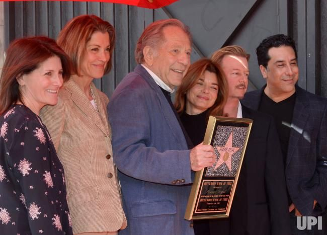 """Actor George Segal is joined by his """"The Goldberg's cast members during a ceremony honoring him with the 2,062nd star on the Hollywood Walk…"""