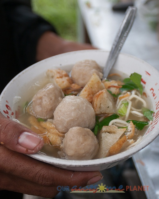 Bakso is popular street food which is a meat-ball soup dish.      Essentially  these are  meat balls, tofu with noodles, celery, fried shallots, and hot beef broth.