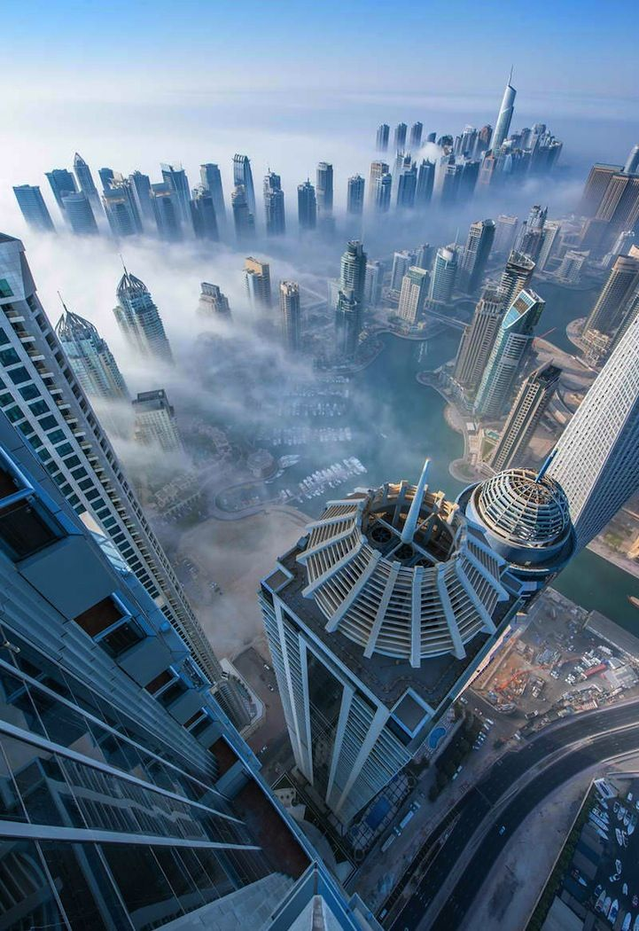 Dubai, by German photographer Sebastian Opitz - 4 to 6 days a year  the mist passes through the city. In that time, the spectacle starts early in morning, sometime round 4 AM, and fully recedes by 9 AM.