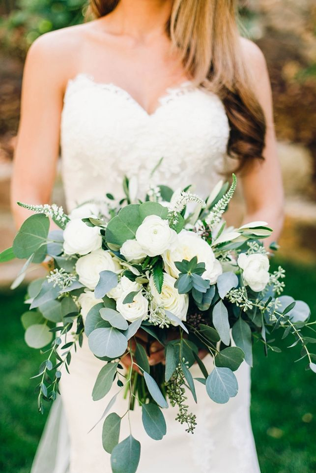 Brides Bouquet by Primary Petals.  Made with: white patience garden roses, cream garden roses, veronica, white ranunculus, olive branches, and a blend of different varieties of eucalyptus. #primarypetals