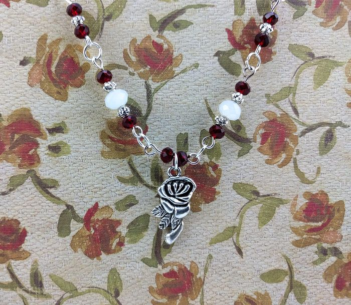 Red and White Faceted Crystal with Silver Accents, and a Rose Charm Bracelet by KoningStilsonDesign on Etsy