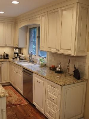 cream cabinets with Cocoa Glaze  NVG Granite white subway tile by Rachel Frederick Winters