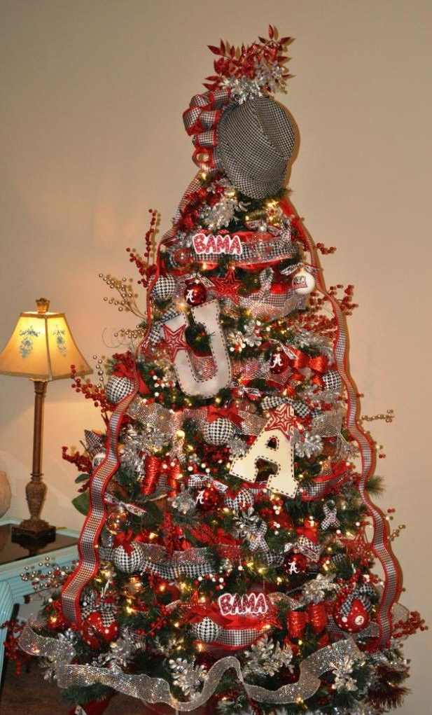 The traditional Bama tree. Lots of houndstooth ribbon, silver deco mesh, and red wired ribbon. love the hat