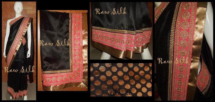 Black semi Raw Silk saree with black and peachy pink zari borders.