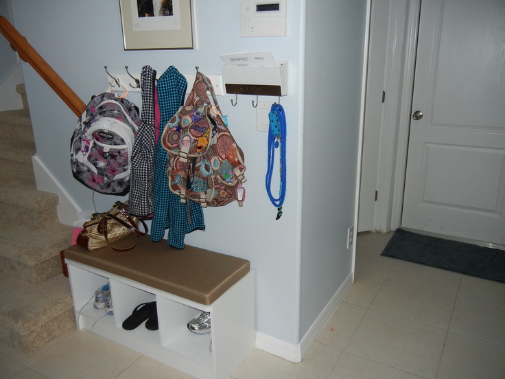 After months of stepping on shoes and backpack in my entry next to the stairs and searching Pinterest for ideas...I found a great bench, hanging rack, and a mail holder with a rack for hanging keys at Target. It was just the solution I needed to fit in my small space!!! Mudroom done!