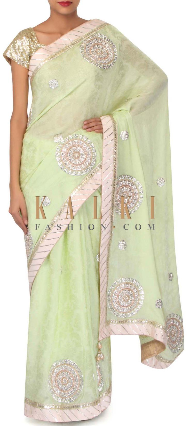 Pista green saree adorn in patch work butti only on Kalki