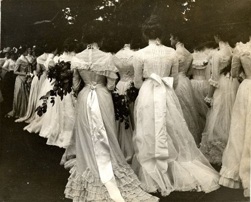 Edwardian ladies at a ball. What beautiful dresses!