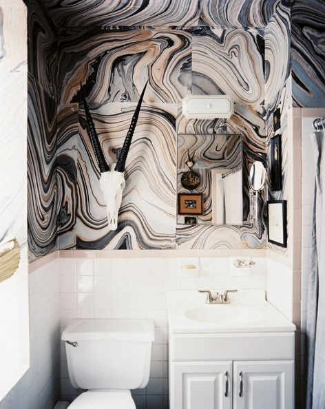 I don't really love this on the wall, but was thinking you could do this on colomns in the home, table, or even a floor w poly coatings on top. Marbled Paper  Nicki Clendening of Scout Designs spruced up the drab walls of her Manhattan apartment's bathroom by applying marbled paper she found at the local art-supply store.
