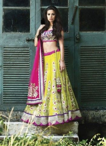 Rein the fashion world in this yellow magenta combination of delight and vibrancy. This outfit showcases your veiled beauty in the most resplendent way and adorn your event with glee and splendour. The scintillating embroidery work over net makes it even more special for a vivacious beauty like you.